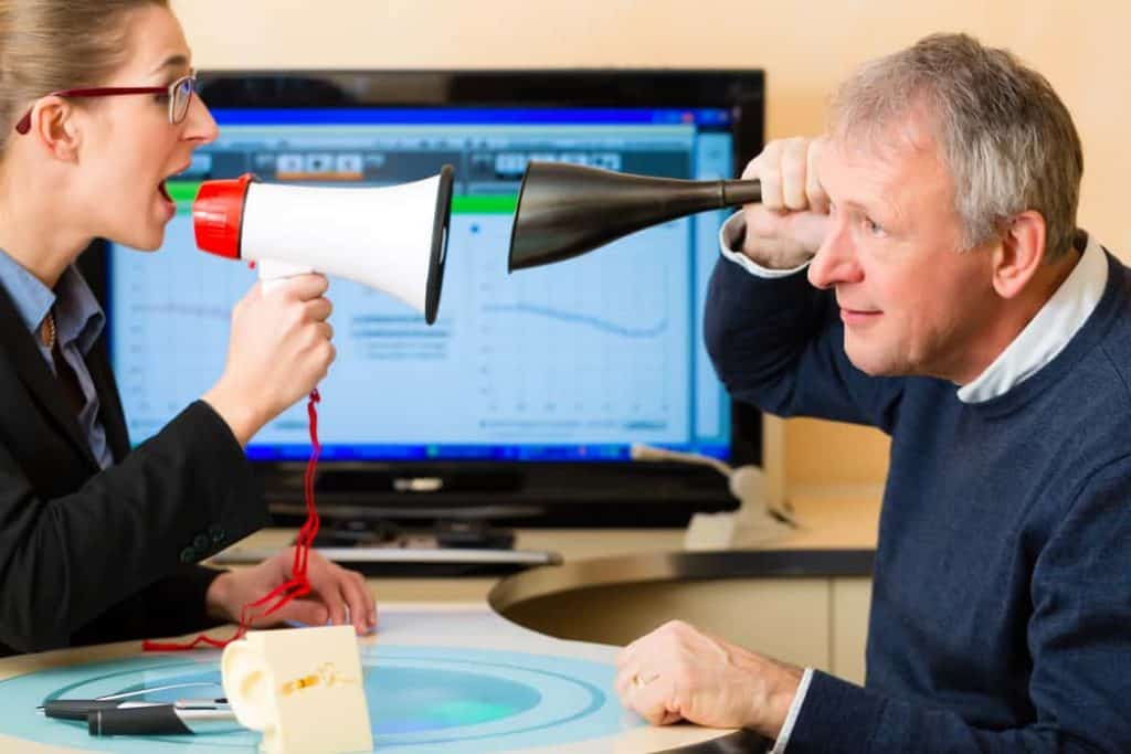 Man at hearing acoustician should take test