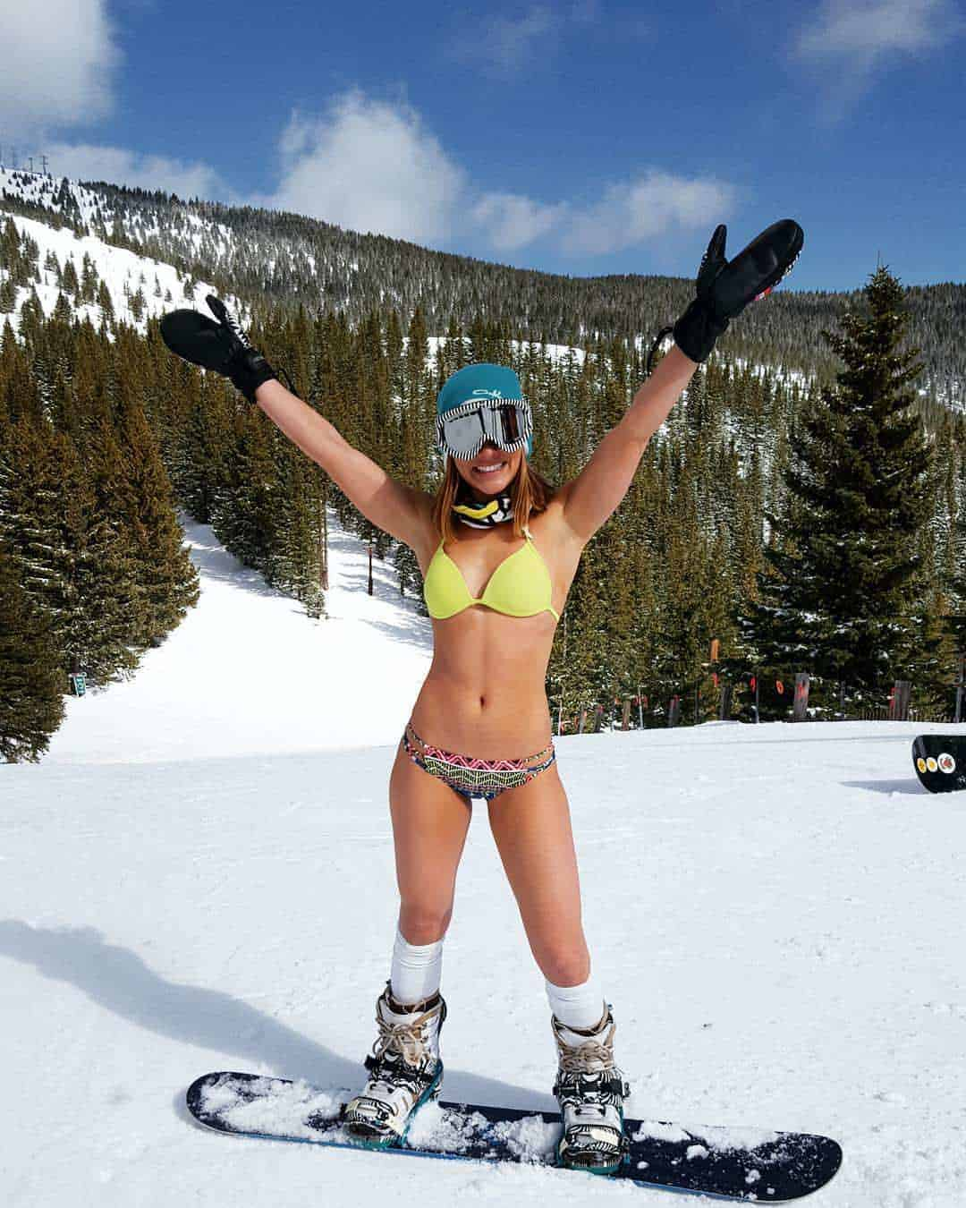 sexy snowboarder female with full equip