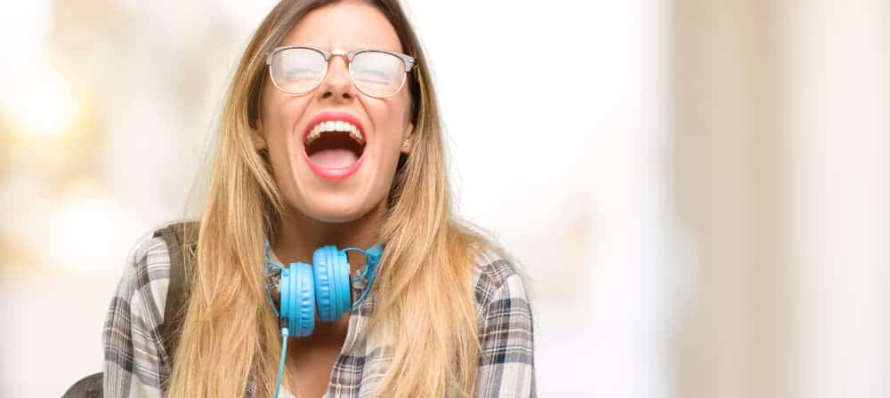 Young student woman with headphones