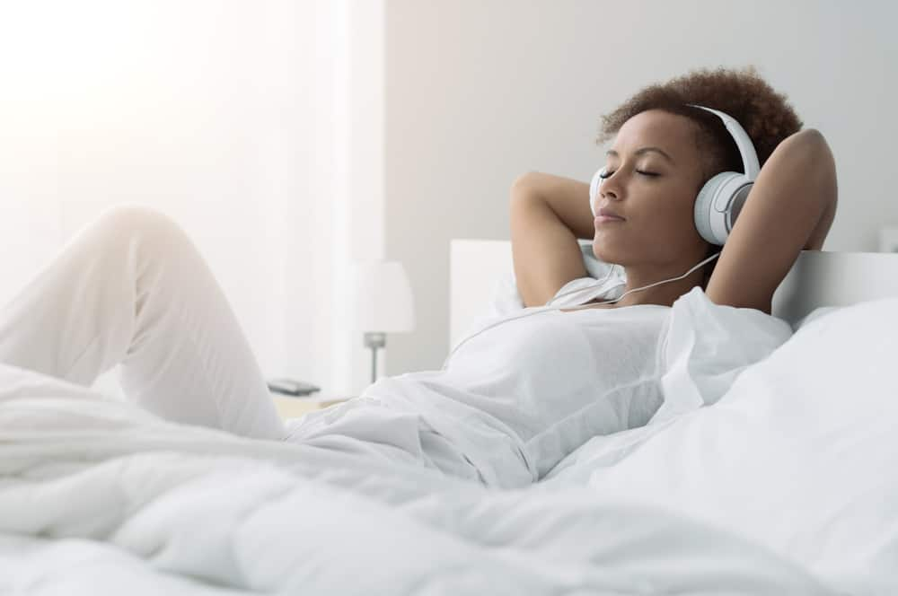Woman relaxing and listening to music